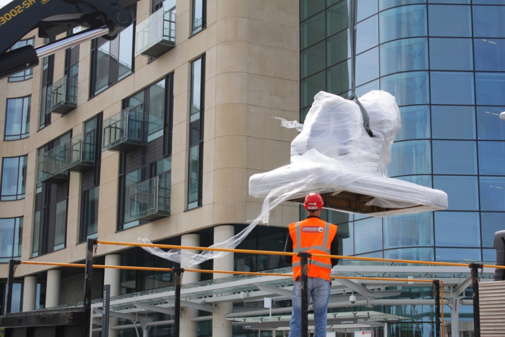 Haulage company installing sculpture at Southmead Hospital Bristol
